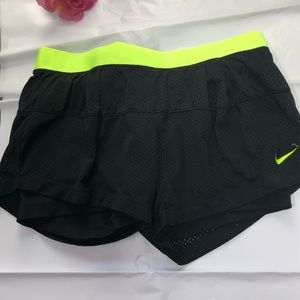 Nike dry fit shorts size black with green trim med